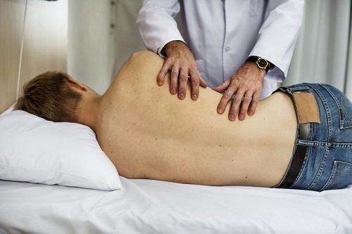 Doctor Massaging Patient