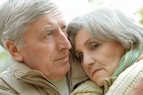 Elderly Couple Grieving Together