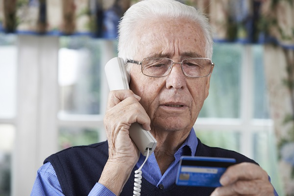 Senior Citizen Looking At Credit Card