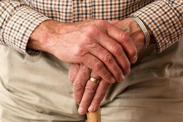senior holding a cane